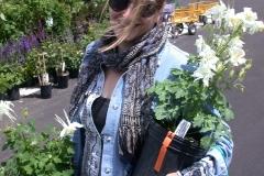 Alisa, holding some rare white columbine for the garden.