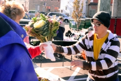 Customer buying cut flowers.